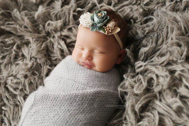 Sparks, Nevada newborn images with baby smiling