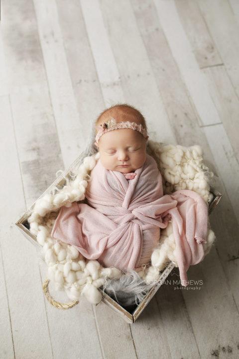 Reno Newborn girl photography wearing a headband