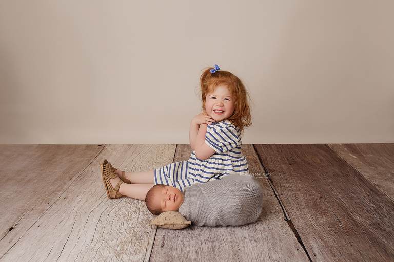 newborn photographer in sparks Nevada and sibling pictures